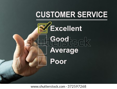 Excellent customer service survey with a businessman hand - stock photo