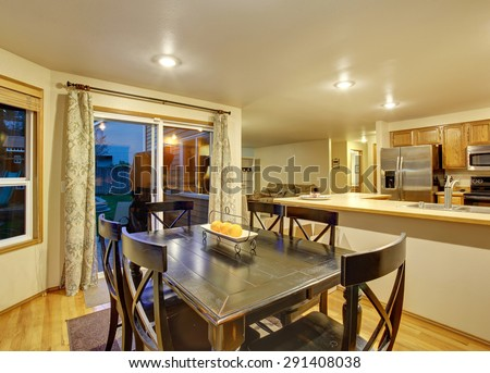 Excellent dinning room with hardwood floor and door. - stock photo