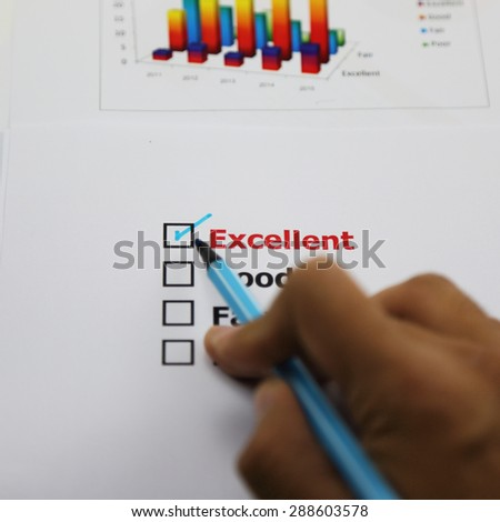 Excellent evaluation. with checked, checked by hand as business concept.