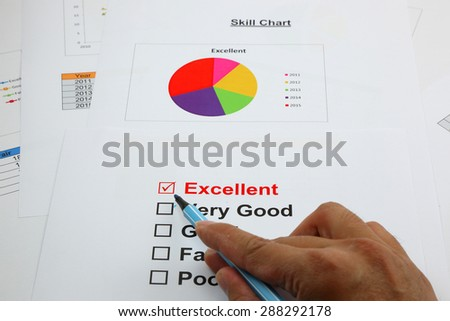 Excellent evaluation. with Excellent checked, selected with hand - stock photo
