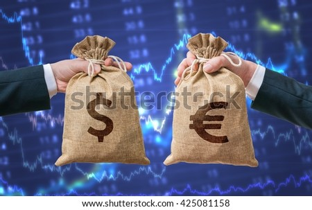 Exchange currency concept. Hands holds bags full of money - Dollar and Euro. - stock photo