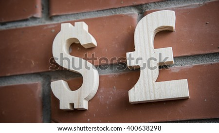 Exchange currency Dollar, Pound on a brick wall - stock photo