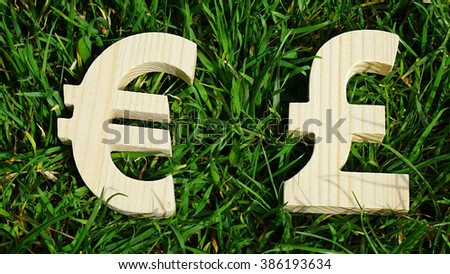 Exchange currency unit on a grass background - stock photo