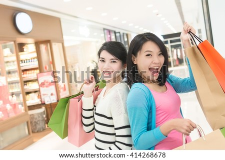 Excite woman go shopping with her friend in department store - stock photo