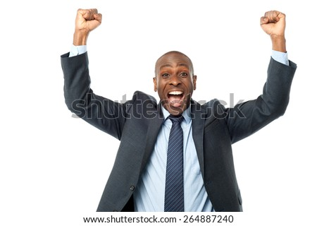 Excited african entrepreneur clenching his fists - stock photo