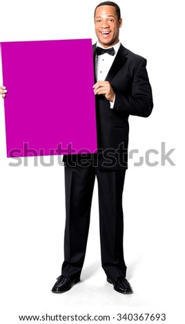 Excited African man with short black hair in evening outfit holding large sign - Isolated