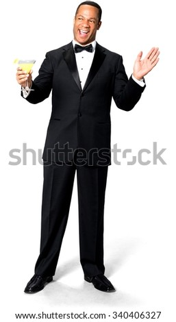Excited African man with short black hair in evening outfit holding martini glass - Isolated