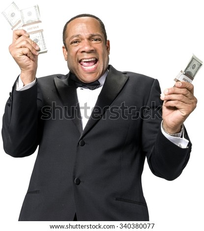 Excited African man with short black hair in evening outfit holding money - Isolated