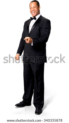 Excited African man with short black hair in evening outfit laughing - Isolated