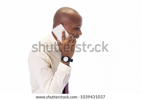 Excited and Happy African American man wearing a shirt and a tie talking on the phone, overwhelming with good news and happiness
