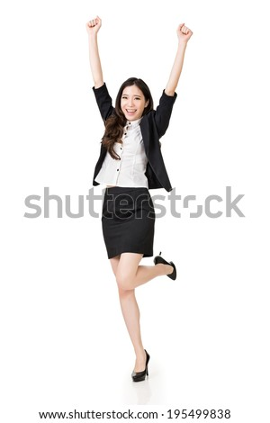 Excited Asian business woman, full length portrait isolated on white background. - stock photo