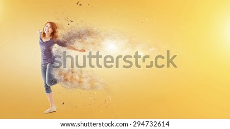 Excited Asian woman dancing with copyspace. - stock photo