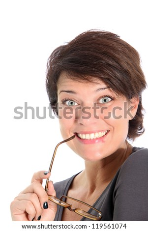Excited attractive woman staring wide eyed at the camera holding her glasses to her mouth isolated on white - stock photo