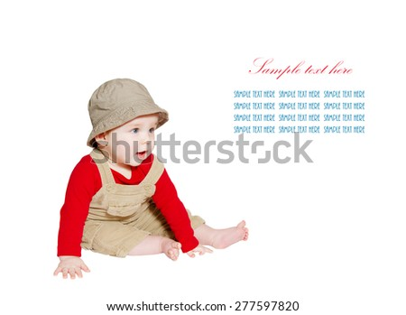 Excited baby explorer/farmer sits on white background. looking at sample text  - stock photo