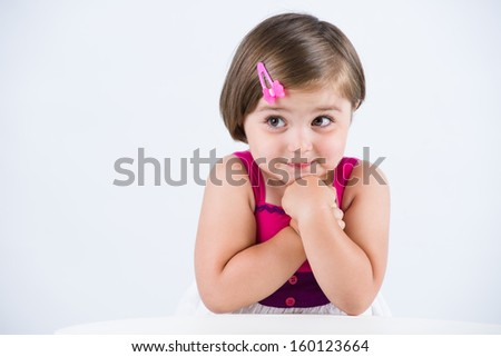 Excited baby girl waiting - stock photo