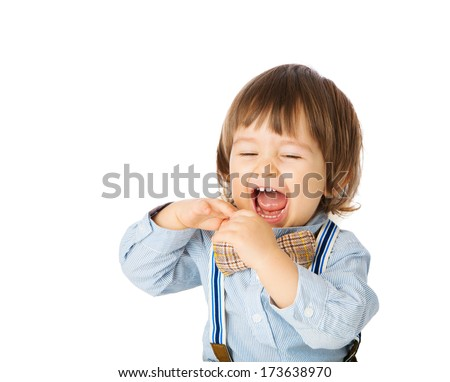 Excited baby with open mouth, showing teeth, face expression, cheerful, happy child in stylish outlook having fun. Studio shot, isolated, over white background, with copy space.