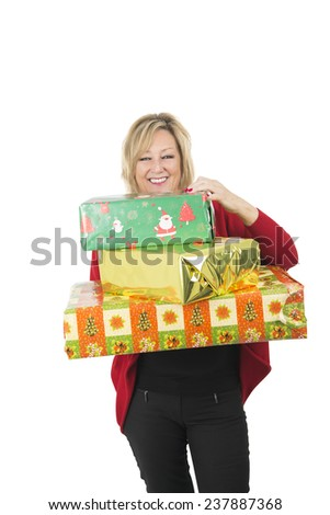 Excited blonde woman holding big christmas presents against a white background - stock photo