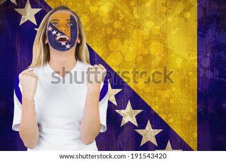 Excited bosnia fan in face paint cheering against bosnia flag in grunge effect - stock photo