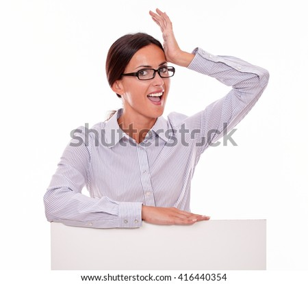 Excited brunette businesswoman gesturing with her left hand on her forehead, wearing her straight hair back looking at the camera with her mouth open in surprise on white background - stock photo