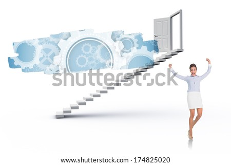 Excited brunette businesswoman jumping and cheering against abstract screen in room showing cogs and wheels - stock photo