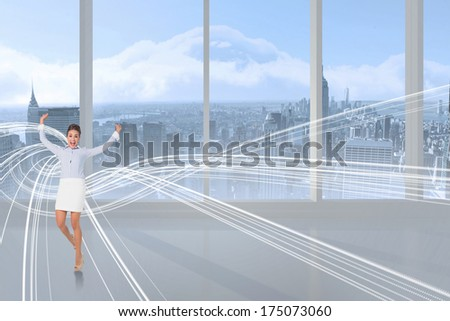 Excited brunette businesswoman jumping and cheering against white design in room - stock photo