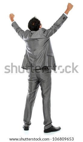 Excited business man with arms raised in success - Isolated on white