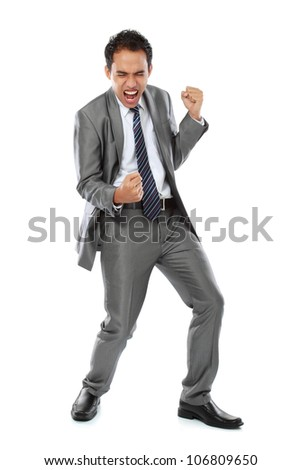 Excited business man with success expression on white background - stock photo