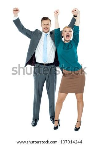 Excited business people celebrating success against white background - stock photo
