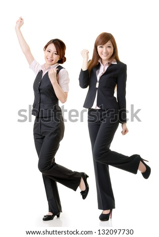 Excited business women, full length portrait of group people isolated on white background. - stock photo