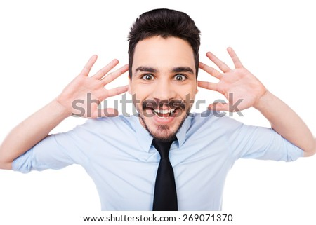 Excited businessman. Happy young man in shirt and tie looking at camera and touching his head with hands while standing against white background - stock photo