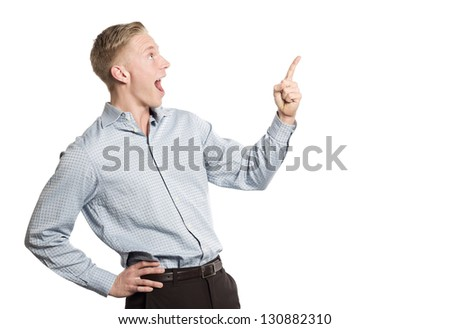 Excited businessman in awe pointing finger up at blank space for text or advertising, isolated on white background. - stock photo