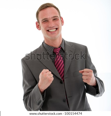 Excited businessman punching his fists in the air in jubilation at the news of his success or promotion