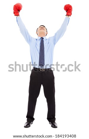 Excited businessman raises arms with gloves - stock photo