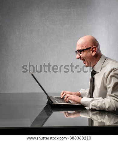 Excited businessman working - stock photo