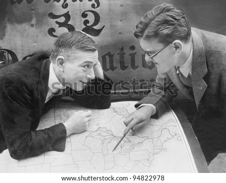 Excited businessmen meeting with map - stock photo