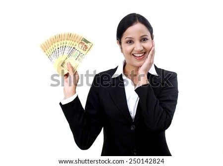 Excited businesswoman holding Indian currency notes - stock photo