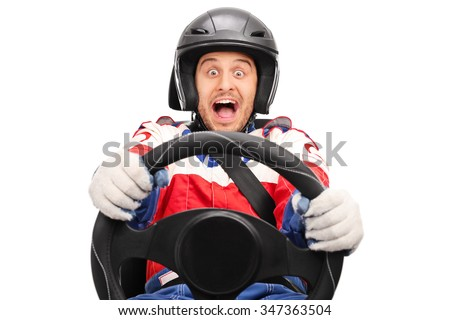 Excited car racer driving very fast fastened with seatbelt and looking at the camera isolated on white background