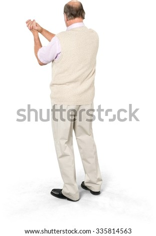 Excited Caucasian elderly man with short grey hair in casual outfit celebrating - Isolated