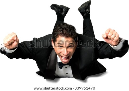 Excited Caucasian man with short black hair in a tuxedo celebrating - Isolated