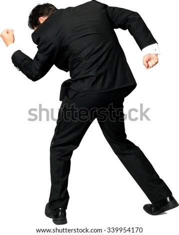 Excited Caucasian man with short black hair in a tuxedo celebrating - Isolated - stock photo