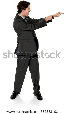 Excited Caucasian man with short dark brown hair in business formal outfit pointing using finger - Isolated