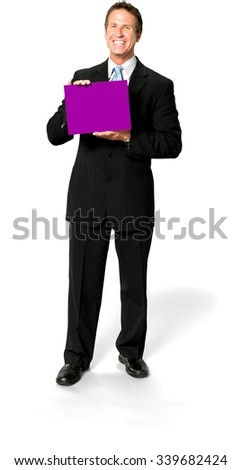 Excited Caucasian man with short medium blond hair in business formal outfit holding medium sign - Isolated