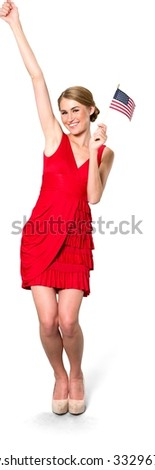 Excited Caucasian young woman with medium blond hair in evening outfit holding mini American flag - Isolated - stock photo