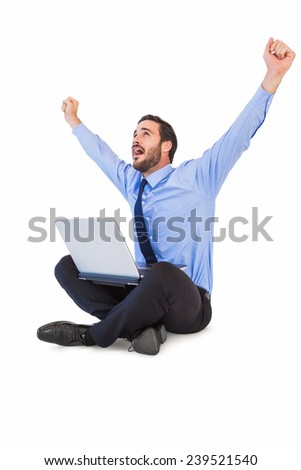 Excited cheering businessman sitting using his laptop on white background - stock photo