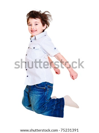 Excited child jumping up high, isolated - stock photo