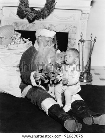 Excited child with Santa Claus - stock photo