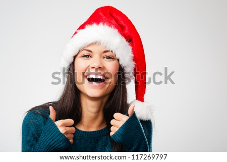 excited christmas woman celebrating and cheering for seasonal holiday isolated on grey background