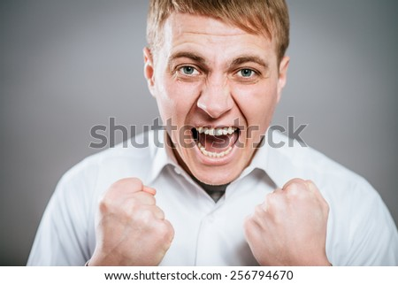 Excited corporate guy clenching his fists