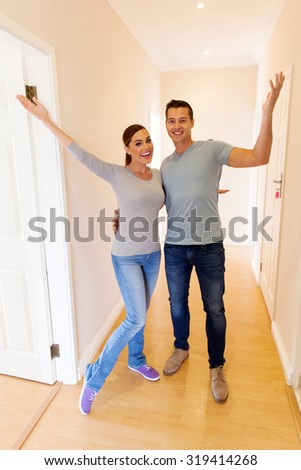 excited couple in their new home - stock photo