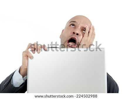 excited desperate businessman in stress at computer laptop holding monitor watching online finances drop down or loosing money online gambling isolated on white background - stock photo